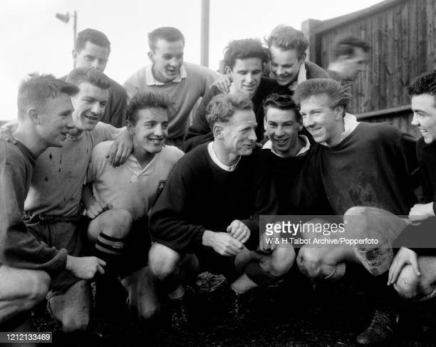 Tom Finney of Preston North End talking to some of the younger players, including Peter Thompson after a training session in Preston, England, circa...