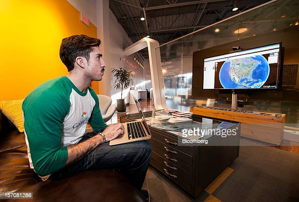 Tom Fitzgerald a Google Inc Fiber Space team member demonstrates upload speeds while using Google Earth in the showroom of the Fiber Space office in...