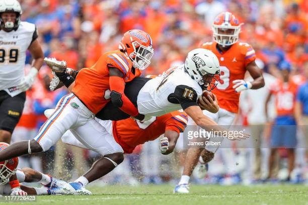 Tom Flacco of the Towson Tigers runs for yardage during the second quarter against the Florida Gators at Ben Hill Griffin Stadium on September 28,...