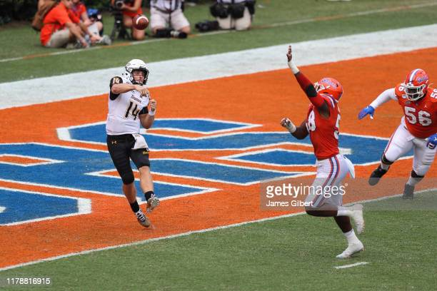 Tom Flacco of the Towson Tigers throws a pass during the third quarter of a game against the Florida Gators at Ben Hill Griffin Stadium on September...