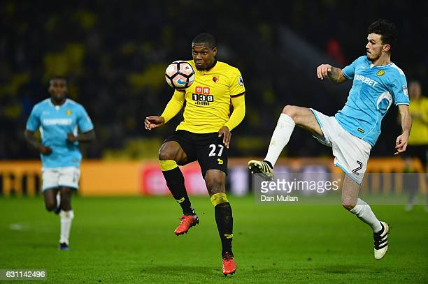 Tom Flanagan of Burton Albion and Christian Kabasele of Watford in action during The Emirates FA Cup Third Round match between Watford and Burton...