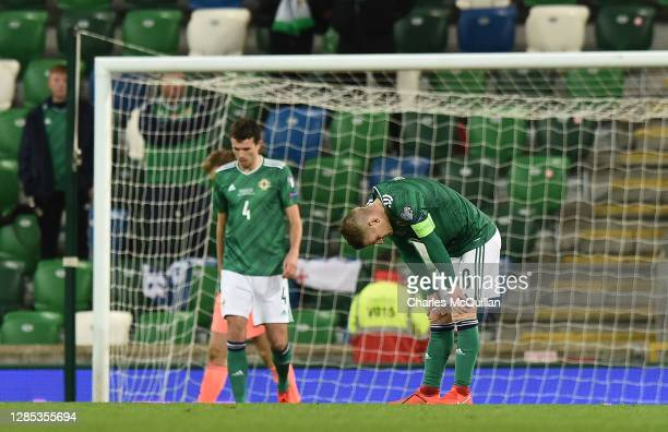 Tom Flanagan of Northern Ireland and Steven Davis of Northern Ireland react after Slovakia score their 2nd goal during the UEFA EURO 2020 Play-Off...