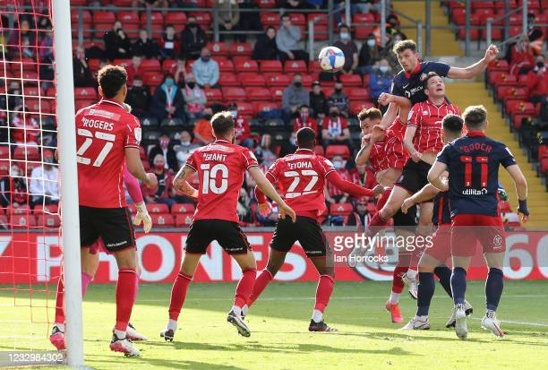 Tom Flanagan of Sunderland wins a header during the Sky Bet League One Play-off Semi Final 1st Leg match between Lincoln City and Sunderland at LNER...