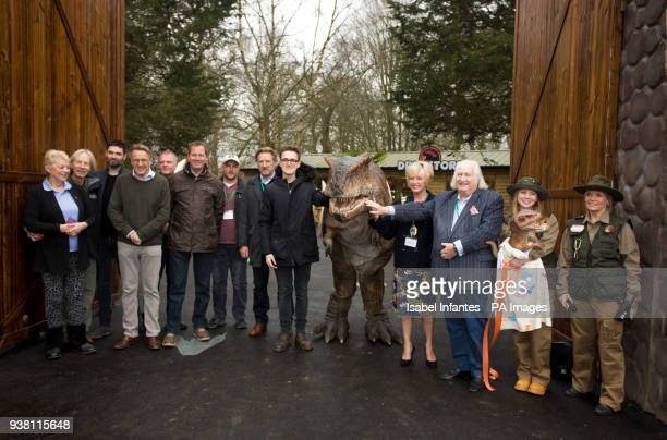 Tom Fletcher cuts the ceremony ribbon accompanied of Emma Willis and Emma Bunton during the opening of World of Dinosaurs a brand new attraction at...