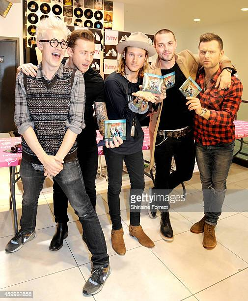 Tom Fletcher Danny Jones Dougie Poynter Matt Willis and Harry Judd of McBusted meet fans and sign copies of their new self titled album at HMV...