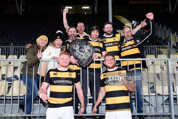 Tom Florence and Bradley Slater of Taranaki pose for a photo with the Ranfurly Shield and Taranaki Supporters during the round 2 Mitre 10 Cup match...