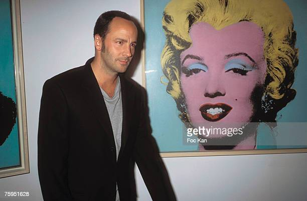 Tom Ford posing front of a Marilyn Monroe by Andy Warhol at the Georges Pompidou Museum Paris March 2001