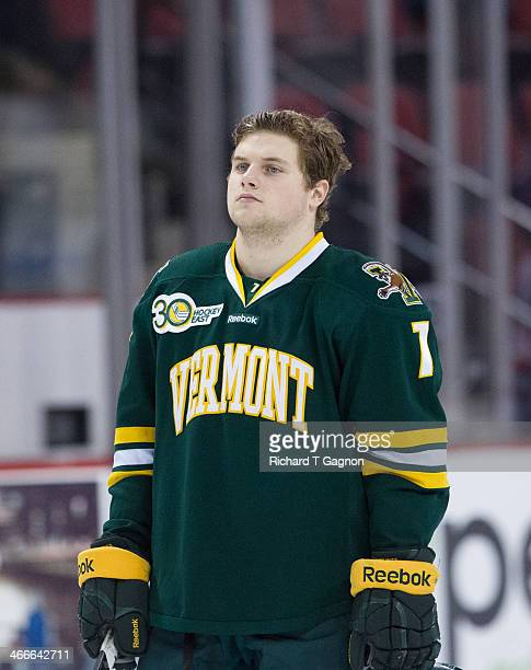Tom Forgione of the Vermont Catamounts listens to the national anthem before NCAA hockey action against the Boston University Terriers at Agganis...