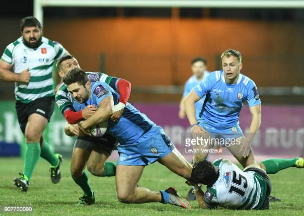 Tom Fowlie of London Irish is tackled during the European Rugby Challenge Cup match between Krasny Yar and London Irish at Avchala Stadium on January...