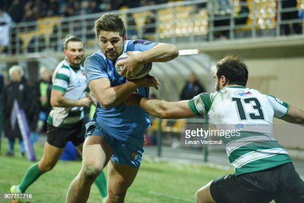 Tom Fowlie of London Irish runs to score during the European Rugby Challenge Cup match between Krasny Yar and London Irish at Avchala Stadium on...