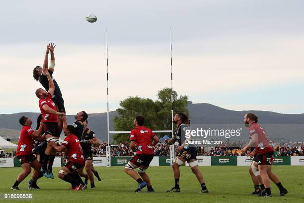 Tom Franklin of the Highlanders and Luke Romano of the Crusaders compete for the lineout ball during the Super Rugby trial match between the...
