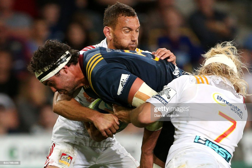 Tom Franklin (L) of the Highlanders in the tackle of AAron Cruden of the Chiefs during the round one Super Rugby match between the Highlanders and the Chiefs at Rugby Park Stadium on February 24, 2017 in Dunedin, New Zealand.