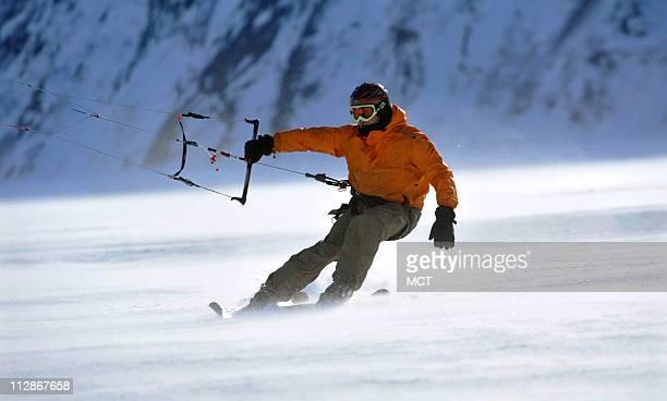 Tom Fredericks snowkites through blowing snow on Portage Lake in Alaska, February 21, 2009.