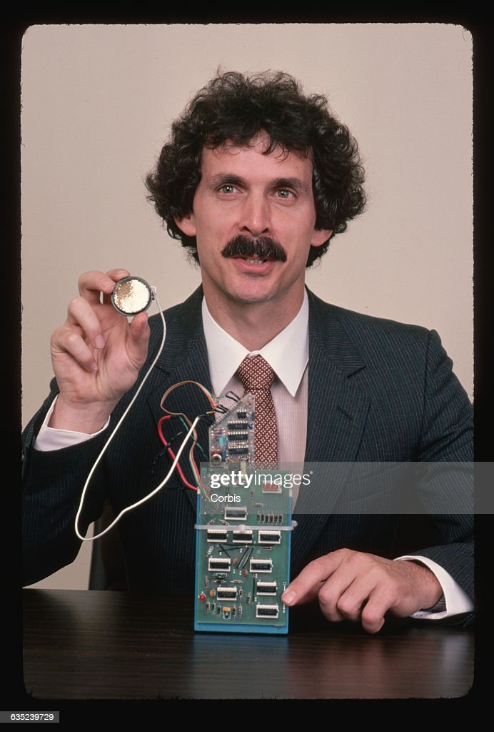 Executive Holding Robot Circuitry : News Photo