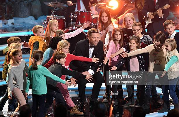 Tom Gaebel Lucky Kids perform during the 'Die schoensten Weinachtshits' TV Show at Bavaria Filmstudios on December 2 2015 in Munich Germany