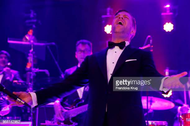 Tom Gaebel performs during the Rosenball charity event at Hotel Intercontinental on May 5 2018 in Berlin Germany