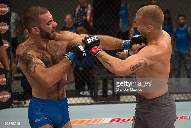 Tom Gallicchio exchanges punches with Marcin Wrzosek during the filming of The Ultimate Fighter: Team McGregor vs Team Faber at the UFC TUF Gym on...