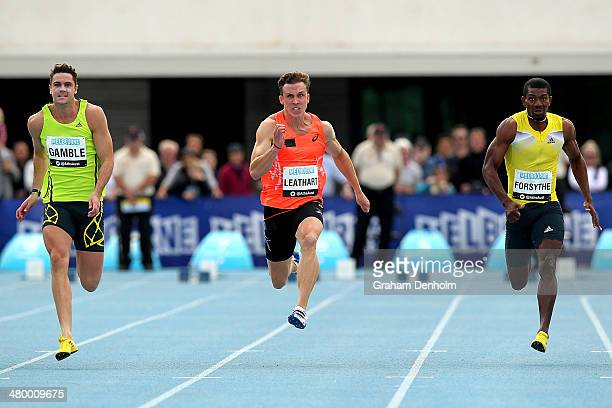 Tom Gamble of Australia Tim Leathart of Australia and Mario Forsythe of Jamaica compete in the Men's 100 metres Open during the IAAF Melbourne World...