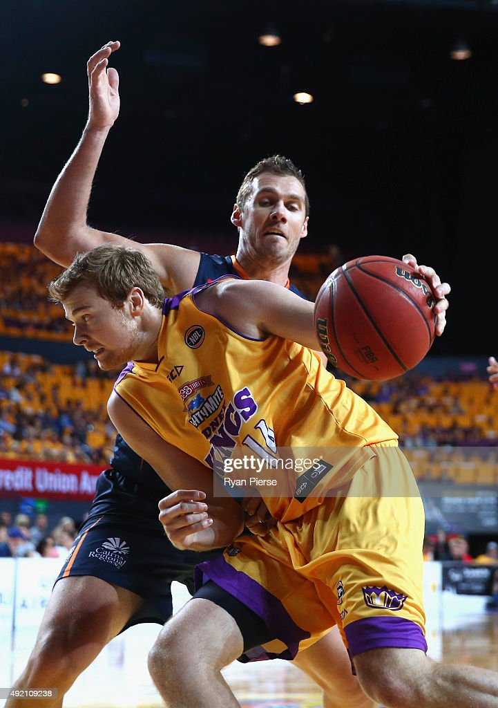 Tom Garlepp of the Kings charges past Alex Loughton of the Taipans during the round one NBL match between the Sydney Kings and the Cairns Taipans at Qantas Credit Union Arena on October 10, 2015 in Sydney, Australia.