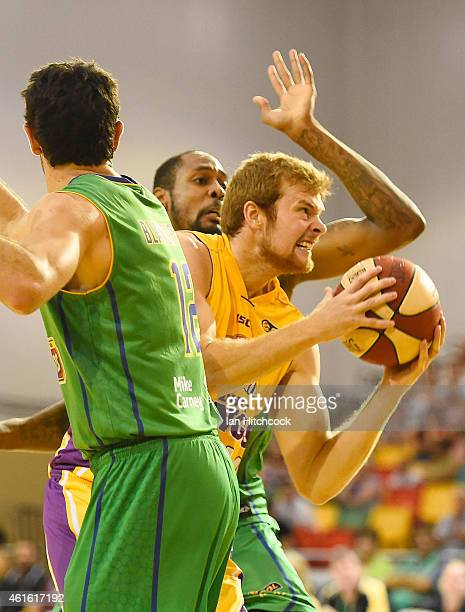 Tom Garlepp of the Kings drives to the basket past Mickell Gladness of the Crocodiles during the round 15 NBL match between the Townsville Crocodiles...