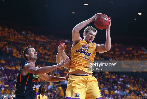 Tom Garlepp of the Kings wins the ball over Alex Loughton of the Taipans during the round one NBL match between the Sydney Kings and the Cairns...
