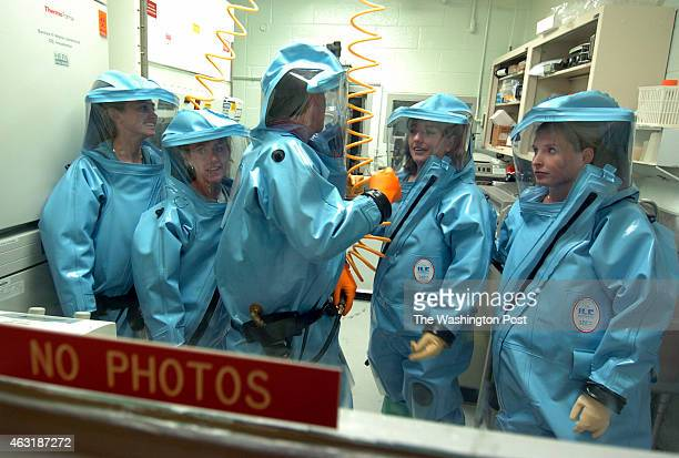 Tom Geisbert center and his team of virologist Joan Geisbert left Tom's wife Katie DaddarioDiCaprio second Lisa Hensley second from right and Liz...