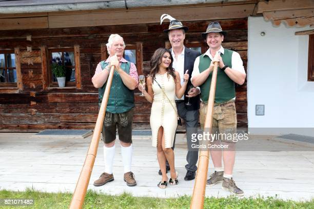 Tom Gerhardt and his wife Nadja da Silva and Alphorn player during the wedding of Torsten Koch and Annika Hofmann at Wiesergut Alm on July 22 2017 in...