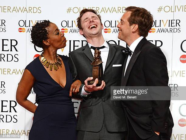 Tom Gibbons winner of the Best Sound Design award for 'People Places and Things' poses with presenters Noma Dumezweni and Stephen Campbell Moore in...