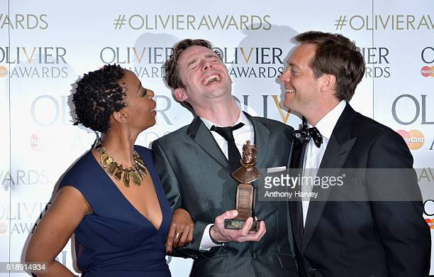 Tom Gibbons winner of the Best Sound Design award for 'People Places and Things' poses with presenters Noma Dumezweni and Stephen Campbell Moore pose...