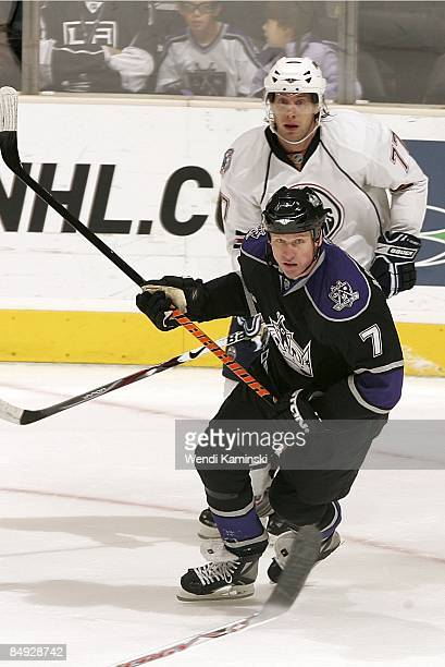 Tom Gilbert of the Edmonton Oilers defends against Derek Armstrong of the Los Angeles Kings during the game on February 14 2009 at Staples Center in...