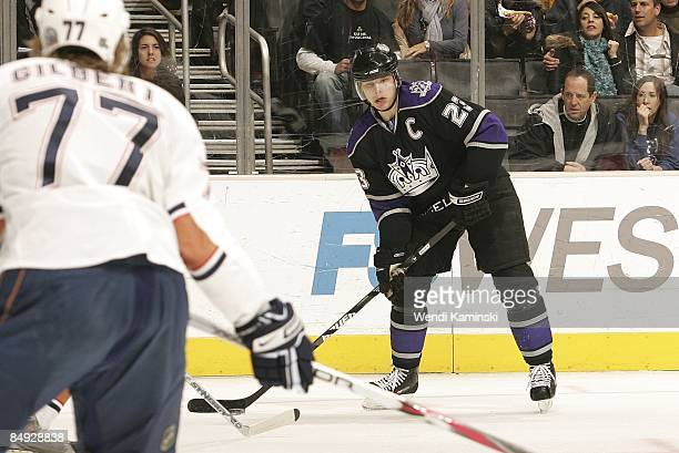 Tom Gilbert of the Edmonton Oilers defends against Dustin Brown of the Los Angeles Kings during the game on February 14 2009 at Staples Center in Los...