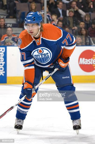 Tom Gilbert of the Edmonton Oilers looks on against the Detroit Red Wings at Rexall Place on March 24 2009 in Edmonton Alberta Canada The Red Wings...