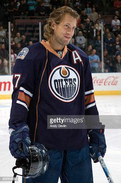 Tom Gilbert of the Edmonton Oilers stands for the National Anthems before a preseason game against the Florida Panthers on September 25 2008 at...