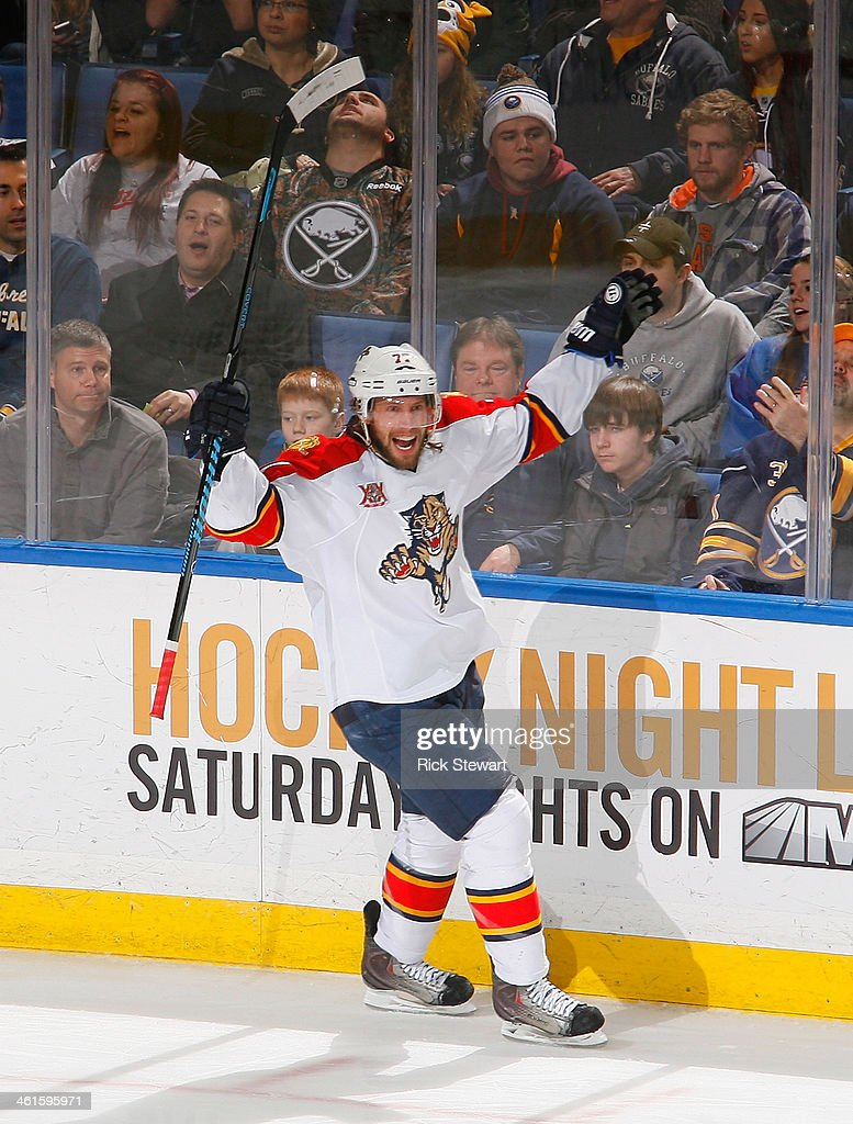 Tom Gilbert #77 of the Florida Panthers celebrates after scoring Florida's first goal of the game against the Buffalo Sabres at First Niagara Center on January 9, 2014 in Buffalo, New York. Florida won 2-1 in a shootout.