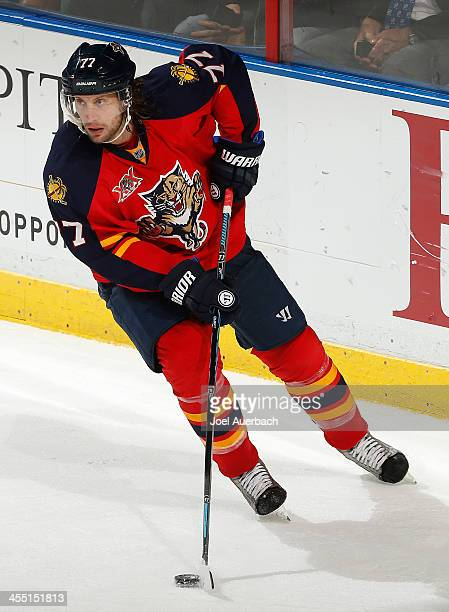 Tom Gilbert of the Florida Panthers clears the puck against the Detroit Red Wings at the BBT Center on December 10 2013 in Sunrise Florida The...