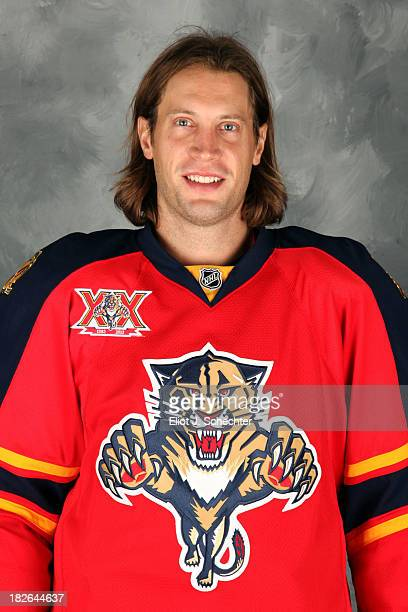 Tom Gilbert of the Florida Panthers poses for his official headshot for the 20132014 NHL season on October 1 2013 in Sunrise Florida