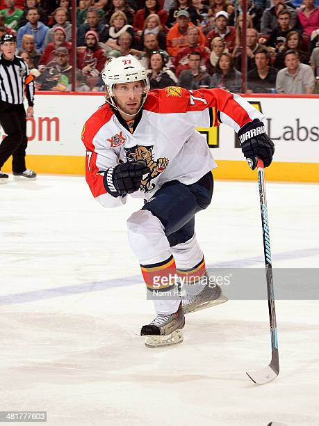 Tom Gilbert of the Florida Panthers skates up ice against the Phoenix Coyotes at Jobingcom Arena on March 20 2014 in Glendale Arizona