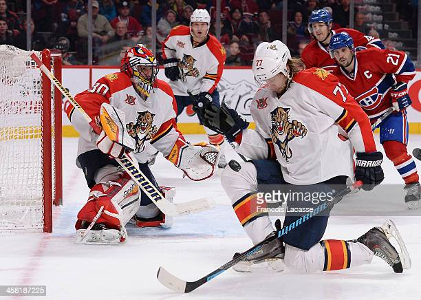 Tom Gilbert of the Florida Panthers stops a puck against the Montreal Canadiens during the NHL game on December 15 2013 at the Bell Centre in...