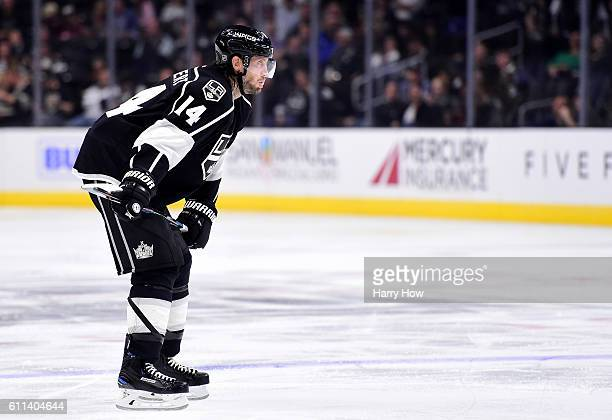 Tom Gilbert of the Los Angeles Kings lines up for a faceoff during a preseason game at Staples Center on September 28 2016 in Los Angeles California