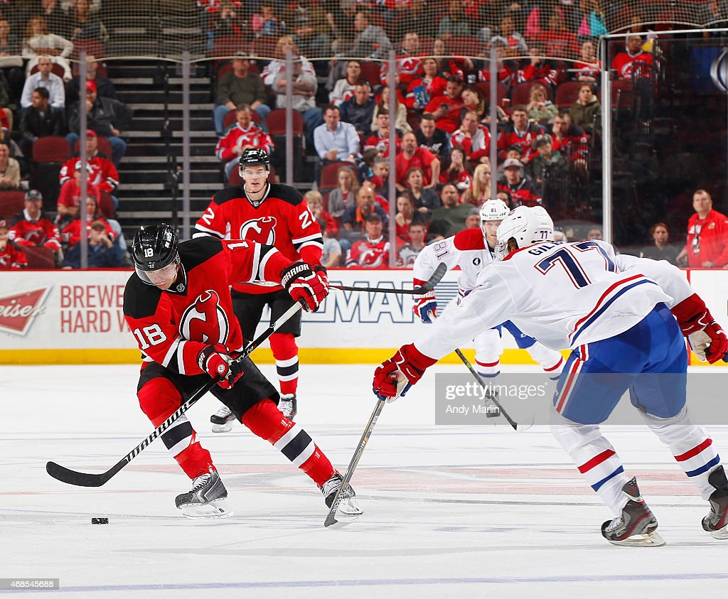 Tom Gilbert #77 of the Montreal Canadiens defends against Steve Bernier #18 of the New Jersey Devils as he plays the puck during the game at the Prudential Center on April 3, 2015 in Newark, New Jersey.