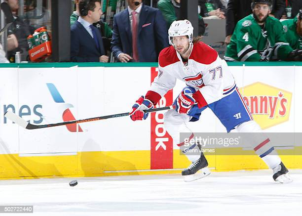 Tom Gilbert of the Montreal Canadiens handles the puck against the Dallas Stars at the American Airlines Center on December 19 2015 in Dallas Texas