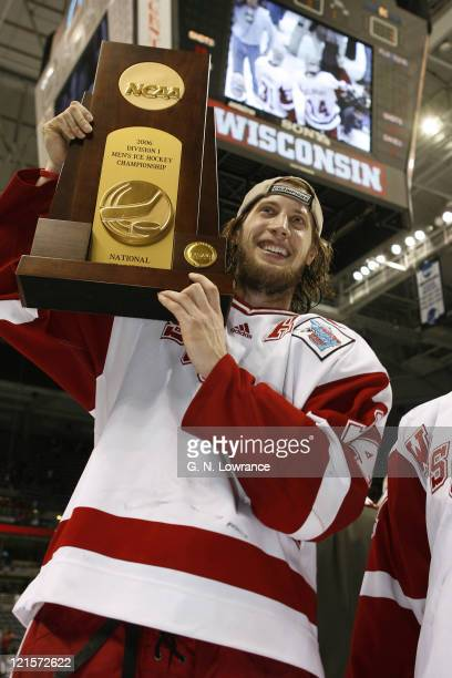 Tom Gilbert of Wisconsin holds the trophy after defeating Boston College 2-1 in the NCAA Mens Hockey National Championship at the Bradley Center in...