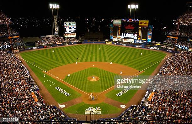 Tom Glavin of the New York Mets throws the first pitch to David Eckstein of the St. Louis Cardinals during game one of the NLCS at Shea Stadium on...