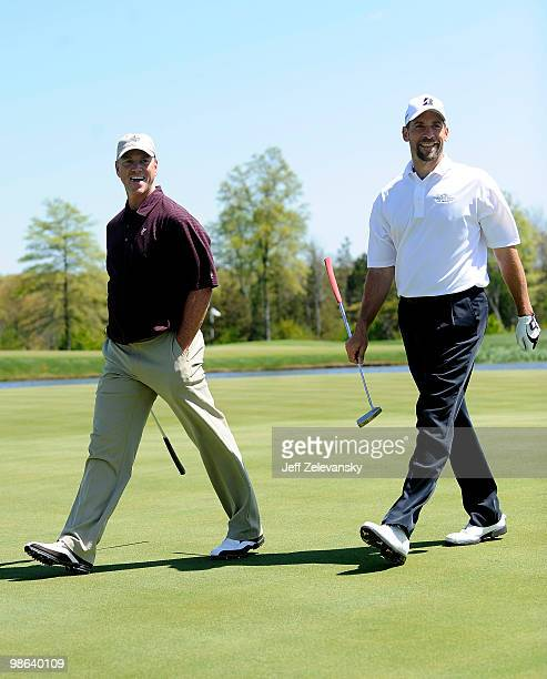 Tom Glavine and John Smoltz walk up the fairway during a taping of Trump's Fabulous World of Golf at the Trump National Golf Club on April 23 2010 in...