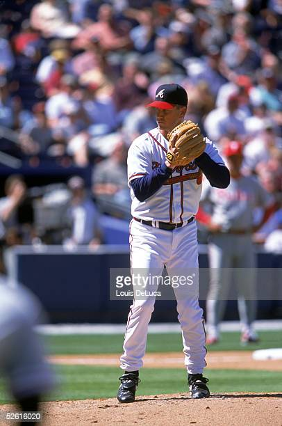 Tom Glavine of the Atlanta Braves gets the signs during the season game at Turner Field in Atlanta Georgia on April 1 2002 Tom Glavine played for the...