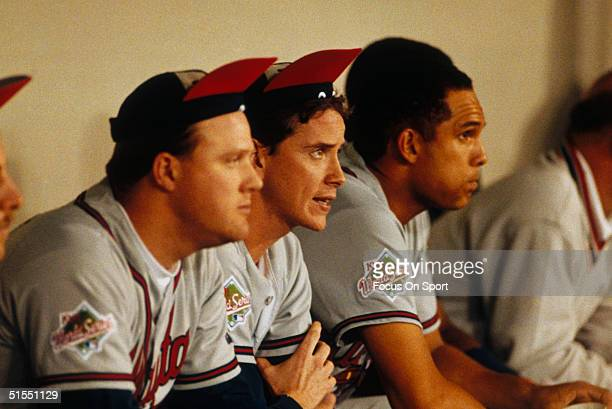 Tom Glavine of the Atlanta Braves joins his teammates as they rally their caps during the World Series against the Minnesota Twins at the Metrodome...