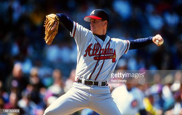 Tom Glavine of the Atlanta Braves pitches against the Chicago Cubs during an MLB game at Wrigley Field in Chicago Illinois Glavine played for the...