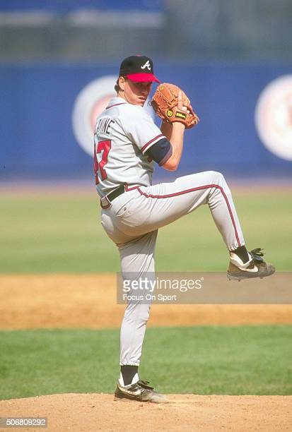 Tom Glavine of the Atlanta Braves pitches against the New York Mets during an Major League Baseball game circa 1997 at Shea Stadium in the Queens...