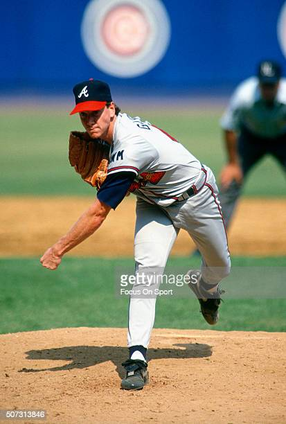 Tom Glavine of the Atlanta Braves pitches against the New York Mets during a Major League Baseball game circa 1990 at Shea Stadium in the Queens...