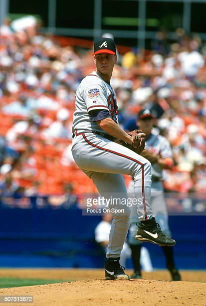 Tom Glavine of the Atlanta Braves pitches against the New York Mets during a Major League Baseball game circa 1997 at Shea Stadium in the Queens...